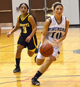 Monica Maschak - mmaschak@shawmedia.com Woodstock North's Brittany Zieman dribbles toward the hoop in a game against Harvard on Monday, December 3, 2012.  The Thunder beat the Hornets 43-24.