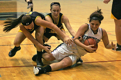 Monica Maschak - mmaschak@shawmedia.com Woodstock North's Melissa Ortiz falls to the ground after battling for control of the ball in a game against Harvard on Monday, December 3, 2012. The Thunder beat the Hornets 43-24.
