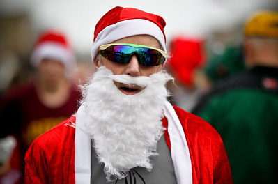 Josh Peckler - Jpeckler@shawmedia.com Keith Zuklke of Harvard breaths heavily after running in the Santa Run-Walk 5K for Kids in downtown Crystal Lake Sunday, December 2, 2012. Hundreds of runners dressed in Santa suits and reindeer antlers to raise money for children in Mchenry County.
