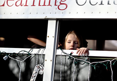 Josh Peckler - Jpeckler@shawmedia.com A young girl looks out the window of a Kindercare Bus as it rode in the Merry Cary Holiday Parade in downtown Cary Sunday, December 2, 2012.