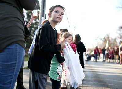 Josh Peckler - Jpeckler@shawmedia.com Cole Copersmet, 7 waits for parade participants to throw out candy during the Merry Cary Holiday Parade in downtown Cary Sunday, December 2, 2012.