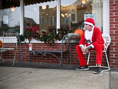 Josh Peckler - Jpeckler@shawmedia.com Joey Dorn, 14 of Crystal Lake takes a break on a chair after running in the Santa Run-Walk 5K for Kids in downtown Crystal Lake Sunday, December 2, 2012. Hundreds of runners dressed in Santa suits and reindeer antlers to raise money for children in Mchenry County.