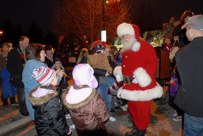 Santa Claus talks to children during Hometown Holidays in Lemont on Saturday, Dec. 1, 2012. Staff photo by Matthew Piechalak