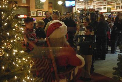 Children line up to see Santa Claus during Hometown Holidays in Lemont on Saturday, Dec. 1, 2012. Staff photo by Matthew Piechalak