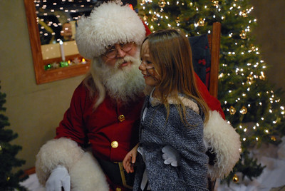 Six-year-old Brooke Mahneke tells Santa Claus what she wants for Christmas during Hometown Holidays in Lemont on Saturday, Dec. 1, 2012. Staff photo by Matthew Piechalak