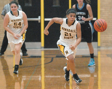 Hinsdale South's Toni Romiti chases down a loose ball during the Hornets' game with Downers Grove South in Darien on Tuesday, Dec. 11, 2012. Staff photo by Bill Ackerman