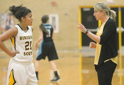 Hinsdale South head coach Jen Belmonte has words on the sideline with Toni Romiti during the Hornets' game with Downers Grove South in Darien on Tuesday, Dec. 11, 2012. Staff photo by Bill Ackerman