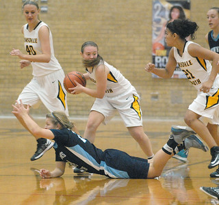 Hinsdale South's Mary Clare Ladd grabs a loose ball during the Hornets' game with Downers Grove South in Darien on Tuesday, Dec. 11, 2012. Staff photo by Bill Ackerman