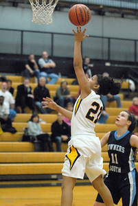 Hinsdale South's Toni Romiti puts up a shot under the basket during the Hornets' game with Downers Grove South in Darien on Tuesday, Dec. 11, 2012. Staff photo by Bill Ackerman