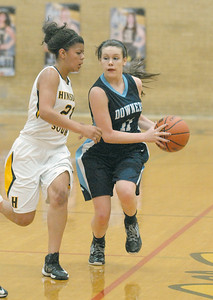 Downers Grove South's Megan Bradshaw drives down court guarded by Hinsdale South's Toni Romiti in Darien on Tuesday, Dec. 11, 2012. Staff photo by Bill Ackerman