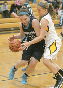 Downers Grove South's Nicole Landrosh drives the baseline against Hinsdale South's Ali Lokanc, before passing on Tuesday, Dec. 11, 2012, in Darien. Staff photo by Bill Ackerman