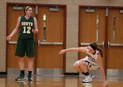 Josh Peckler - Jpeckler@shawmedia.com Crystal Lake South's Carly Nolan looks towards a referee after being call for a foul against Huntley's Samantha Andrews during the second quarter at Huntley High School Tuesday, December 11, 2012.