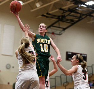 Josh Peckler - Jpeckler@shawmedia.com Crystal Lake South's Stephanie Oros goes up to take a shot over several Huntley defenders during the second quarter at Huntley High School Tuesday, December 11, 2012.