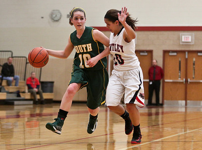 Josh Peckler - Jpeckler@shawmedia.com Crystal Lake South's Stephanie Oros tries to drive the ball past Huntley's Kayla Barreto during the second quarter at Huntley High School Tuesday, December 11, 2012.