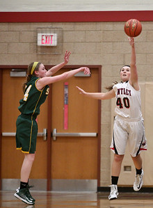 Josh Peckler - Jpeckler@shawmedia.com Huntley's Samantha Andrews (40) attempts to block a shot of Crystal Lake South's Chanel Fanter during the first quarter at Huntley High School Tuesday, December 11, 2012.