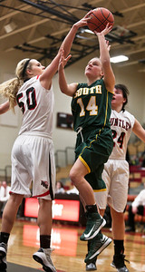 Josh Peckler - Jpeckler@shawmedia.com Crystal Lake South's Kelly Ryan has her shot blocked by Huntley's Ali Andrews during the second quarter at Huntley High School Tuesday, December 11, 2012.