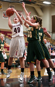 Josh Peckler - Jpeckler@shawmedia.com Huntley's Samantha Andrews (40) goes up to take a shot in front of Crystal Lake South's Stephanie Oros during the first quarter at Huntley High School Tuesday, December 11, 2012.