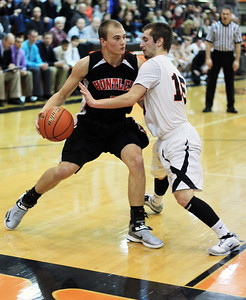 Sarah Nader - snader@shawmedia.com Crystal Lake Central's Brad Knoeppel (right) guards Huntley's Blake Jacobs during the third quarter of Friday's game in Crystal Lake on December 14, 2012.