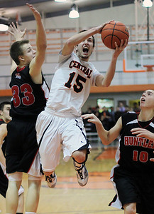 Sarah Nader - snader@shawmedia.com Crystal Lake Central's Brad Knoeppel makes a shot during Friday's game against Huntley in Crystal Lake. Crystal Lake Central won, 54-46.