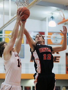 Sarah Nader - snader@shawmedia.com Crystal Lake Central's DJ Thomas (left) and Huntley's Jake Wagner both jump for the rebound during the fourth quarter of Friday's game in Crystal Lake on December 14, 2012.