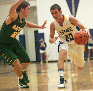 Monica Maschak - mmaschak@shawmedia.com Drew Talbot (20), for Johnsburg, dribbles past a defender in a home game against Crystal Lake South on Wednesday, December 5, 2012.  Johnsburg won 45-42.