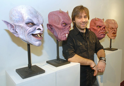 J. Anthony Kosar poses with come of his collector masks on Monday, Dec. 31, 2012. Kosar is a special effects artist and prop maker who also holds classes at his Kosart Effects Studios in Westmont. He will appear on a upcoming reality/competition television show. Bill Ackerman — backerman@shawmedia.com