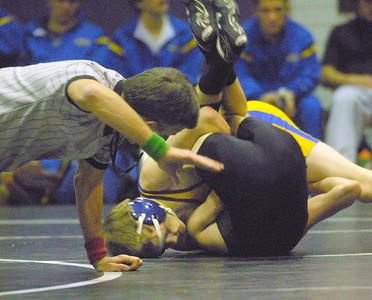 Lyons Township's Mac Casella (top) pins Downers Grove North's Griffen Foster in their 113 pound match in a West Suburban Silver dual varsity wrestling match in Downers Grove on Thursday, Dec. 13, 2012. Bill Ackerman — backerman@shawmedia.com