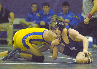 Downers Grove North's Pat Walker (right) wins his 106 pound match with Lyons Township's Will Mertz. Downers wins a close West Suburban Silver dual varsity wrestling match, 29-28, at home on Thursday, Dec. 13, 2012. Bill Ackerman — backerman@shawmedia.com