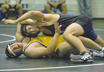 Downers Grove North's Al Johnson (top) wins his 170 pound match with Lyons Township's Robert Fraire. Downers North wins a close West Suburban Silver dual varsity wrestling match, 29-28, at home on Thursday, Dec. 13, 2012. Bill Ackerman — backerman@shawmedia.com