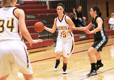 Monica Maschak - mmaschak@shawmedia.com Richmond-Burton's Abby Lytle launches the ball to her teammate in a game against Woodstock North at the Northern Illinois Holiday Classic on Saturday, December 15, 2012. The lady Thunder took out the lady Rockets 54-46.