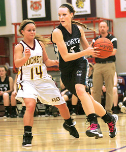 Monica Maschak - mmaschak@shawmedia.com Samantha Arr (5) looks to pass around her Richmond-Burton opponent during the final game of the Northern Illinois Holiday Classic on Saturday, December 15, 2012. Woodstock North beat Richmond-Burton 54-46.