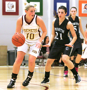 Monica Maschak - mmaschak@shawmedia.com Richmond-Burton's Alex Callanan peers for an open teammate in a game against Woodstock North at the Northern Illinois Holiday Classic on Saturday, December 15, 2012. The lady Thunder took out the lady Rockets 54-46.