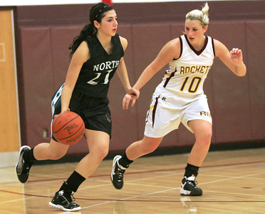 Monica Maschak - mmaschak@shawmedia.com Samantha Abbate (21) dribbles to find an open area in the final game of the Northern Illinois Holiday Classic on Saturday, December 15, 2012. Woodstock North beat Richmond-Burton 54-46.