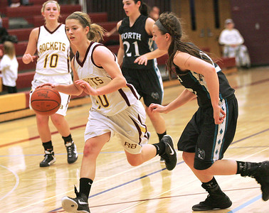 Monica Maschak - mmaschak@shawmedia.com Samantha Boettjer, for the lady Rockets, rushes down the court in a game against Woodstock North during the Northern Illinois Holiday Classic on Saturday, December 15, 2012. Woodstock North won 54-46.