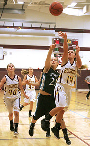 Monica Maschak - mmaschak@shawmedia.com Richmond-Burton's Hali Hoglund fires at the hoop in a game against Woodstock North at the Northern Illinois Holiday Classic on Saturday, December 15, 2012. The lady Thunder took out the lady Rockets 54-46.