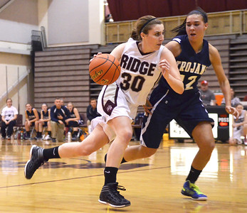 Monica Maschak - mmaschak@shawmedia.com Kelsey Bear (30) moves past her opponent Joslyn Nicholson in the second half of the Prairie Ridge game against Cary-Grove on Tuesday, December 4, 2012.  The Cary-Grove Trojans won 47-29.