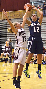Monica Maschak - mmaschak@shawmedia.com Cary-Grove's Joslyn Nicholson fires the ball toward the hoop during a game at Prairie Ridge High School on Tuesday, December 4, 2012.  The Trojans beats the Wolves 47-29.