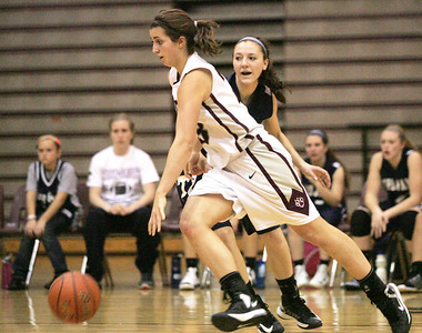 Monica Maschak - mmaschak@shawmedia.com Prairie Ridge forward Alex Neckopulos dribbles around her opponent in a game against Cary-Grove on Tuesday, December 4, 2012.  The Trojans beats the Wolves 47-29.