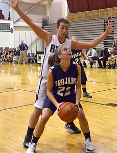 Monica Maschak - mmaschak@shawmedia.com Cary-Grove's Megan Leisten looks for an opening to the hoop as a defender stands over her in a game at Prairie Ridge High School on Tuesday, December 4, 2012.  The Trojans beats the Wolves 47-29.