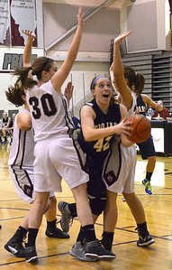 Monica Maschak - mmaschak@shawmedia.com Cary-Grove's Olivia Jakubicek pushes through the defense to take a shot at the hoop in a game at Prairie Ridge High School on Tuesday, December 4, 2012.  The Trojans beats the Wolves 47-29.