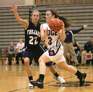 Monica Maschak - mmaschak@shawmedia.com Brianne Fenton, for Prairie Ridge, rushes the ball down the court in a game against Cary-Grove on Tuesday, December 4, 2012.  The Trojans beats the Wolves 47-29.