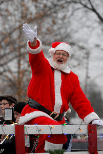 Santa Claus waves to the crowd during the annual Lights of Lisle Festival along Main Street on Saturday, Dec. 1, 2012. Staff photo by Matthew Piechalak