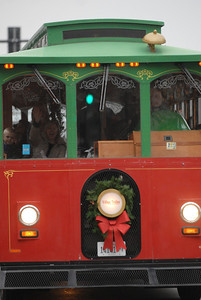 People aboard a holiday trolley wave through the windows during the annual Lights of Lisle Festival along Main Street on Saturday, Dec. 1, 2012. Staff photo by Matthew Piechalak