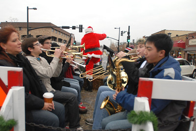 The Lisle Junior High band performs holiday songs while riding with Santa Claus during the annual Lights of Lisle Festival along Main Street on Saturday, Dec. 1, 2012. Staff photo by Matthew Piechalak