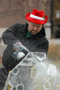 Ice Man Dan carves a Christmas tree out of an ice block during the annual Lights of Lisle Festival along Main Street on Saturday, Dec. 1, 2012. Staff photo by Matthew Piechalak