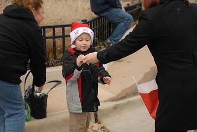 Ryan Olszewski, 4, of Lisle takes a piece of candy during the annual Lights of Lisle Festival along Main Street on Saturday, Dec. 1, 2012. Staff photo by Matthew Piechalak