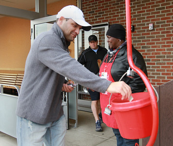 Tracy Mayberry attracts donors by ringing her bell for the Salvation Army at the Jewel-Osco on the corner of Maple and Route 53 in Lisle. Staff photo by Sarah Minor
