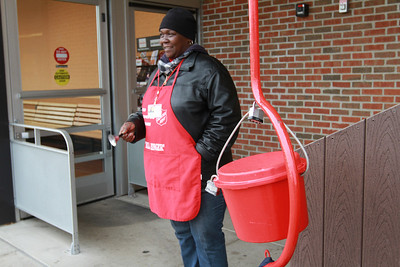 Salvaion Army bell ringer Tracy Mayberry rings her bell at the Jewel-Osco on the corner of Maple and Route 53 in Lisle. Staff photo by Sarah Minor