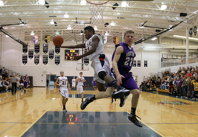 Lamont Ross of Lisle goes up for a shot after getting a steal in their game against Manteno on Friday, Dec. 14. Sarah Minor — sminor@shawmedia.com