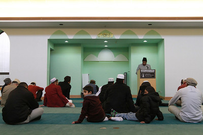 Men pray at the Masjid Baet-ul-Jaamay mosque on Friday, Dec. 7. Staff photo by Sarah Minor